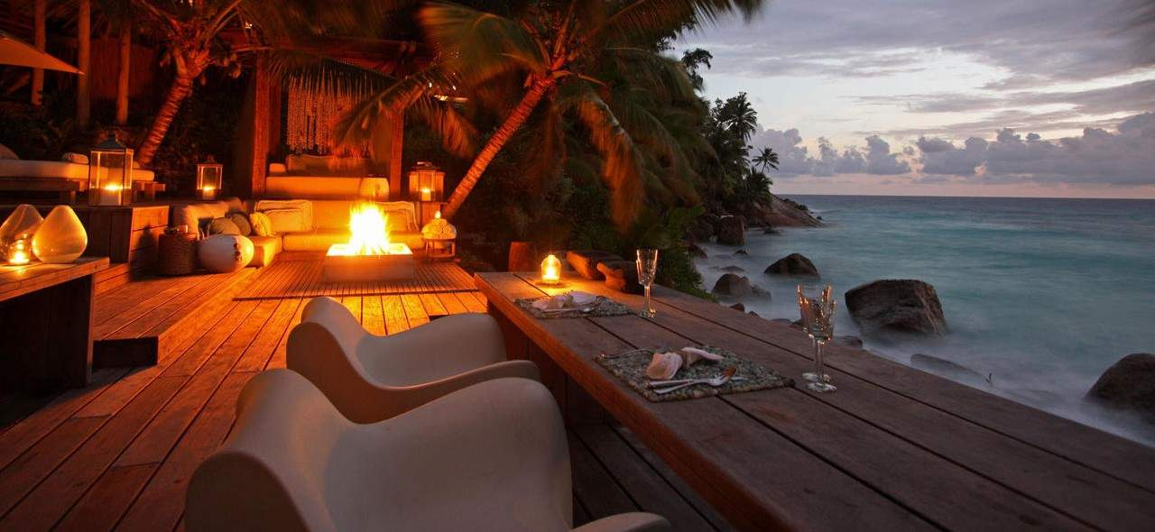 Romantic sunset seaside dinner North Island Seychelles