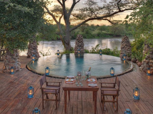 Dining-at-the-swimming-pool-at-andbeyond-grumeti-on-a-luxury-tanzania-safari