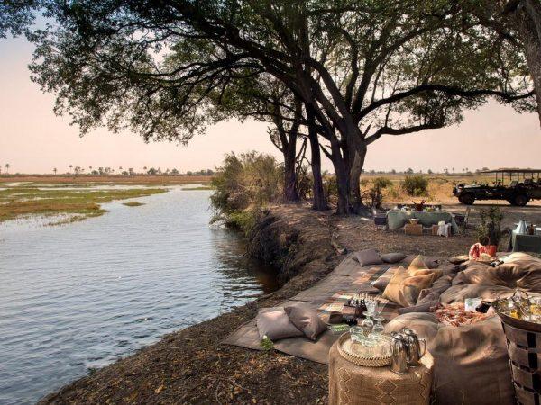 AndBeyond Sandibe Okavango Safari Lodge bush dining