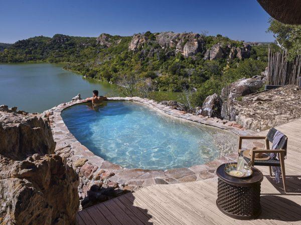 Singita Pamushana Lodge Plunge pool with a view of the dam