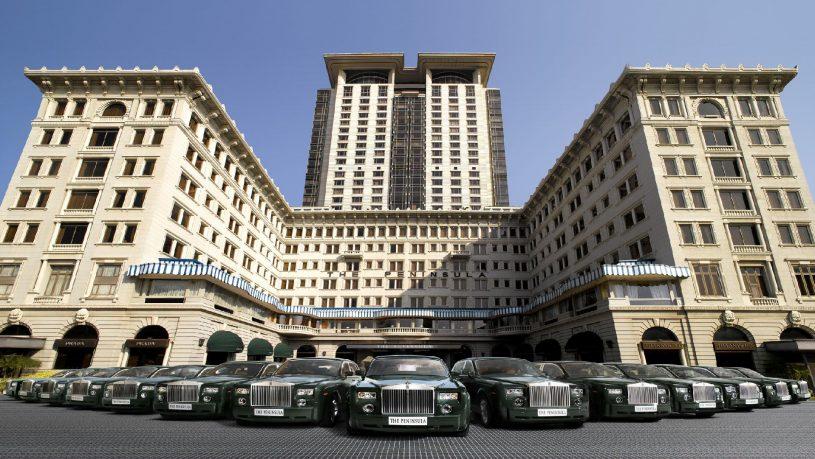The Peninsula Hong Kong exterior with Rolls Royce fleet