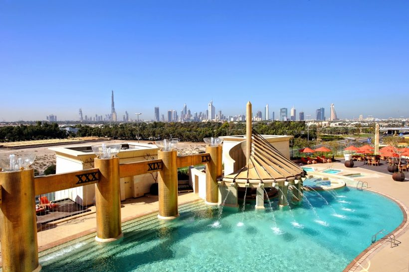 Raffles Dubai Pool and Dubai Skyline View
