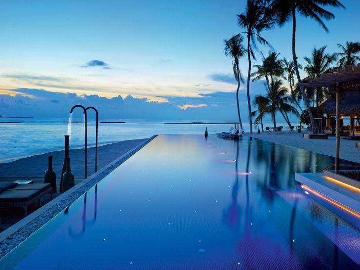 Velaa private island pool sunset