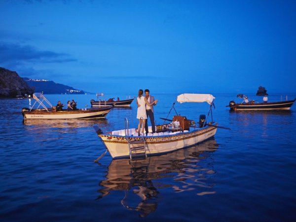 Belmond Villa Sant Andrea beach dinner with floating concert