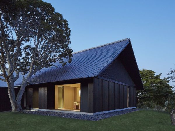 All Suites And Villas Feature Low-Slung Tiled Roofs And Dark Cedar Exteriors