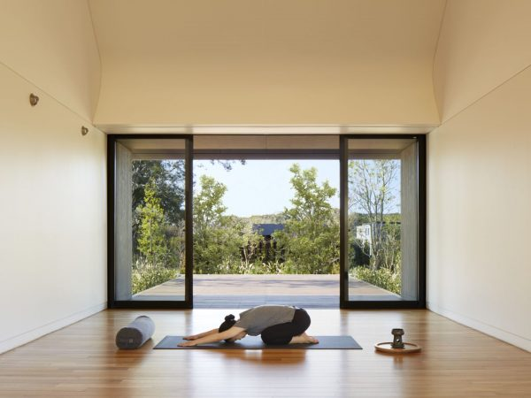The Expansive Glass Walled Studio Includes An Outdoor Yoga Deck With Professional Yoga Equipment And TRX