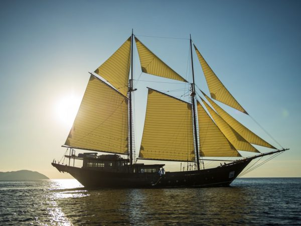 a two-masted sailing ship measuring 52m, was handcrafted by the Konjo tribe and launched in 2015. A traditional Phinisi vessel, it combines the ancient romance of the spice trade with cutting-edge contemporary amenities, sailing the vibrant waters of Indonesia, from Amanwana to Komodo National Park and the Raja Ampat islands.