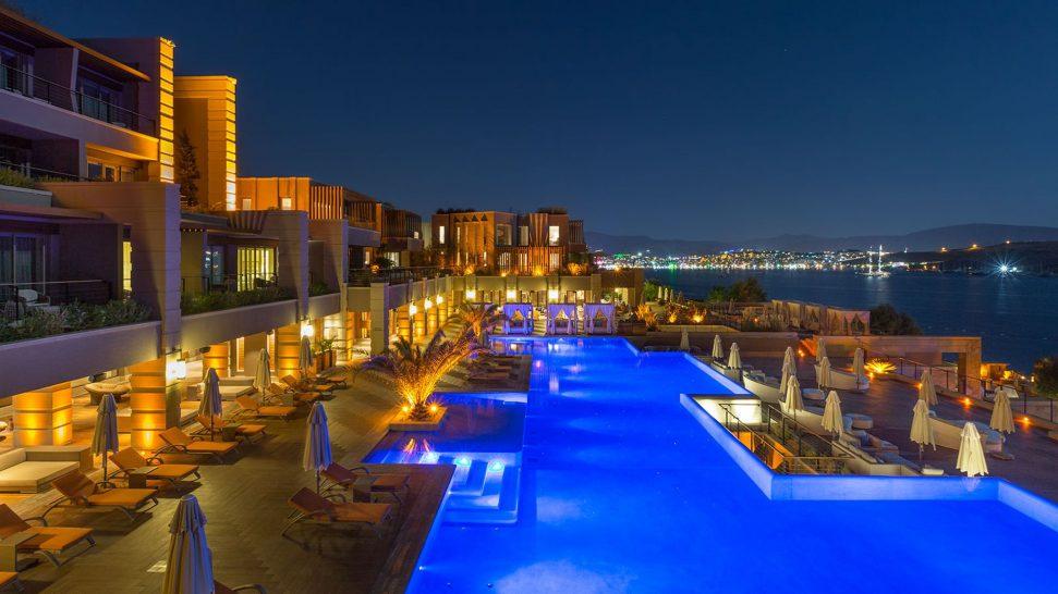 Caresse Bodrum Infinity Pool Area Cabanas At Night