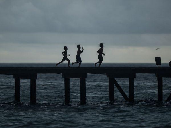 Kids Running on Jetty By Bruno Aveillan