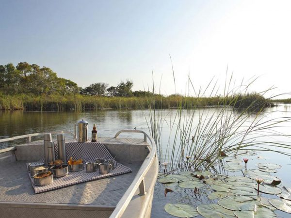 AndBeyond Nxabega Okavango Tented Camp boating