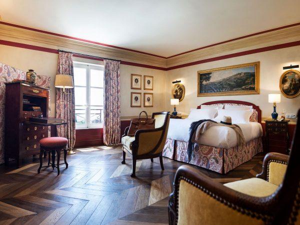 La Bastide De Gordes junior suite bed chairs fireplace