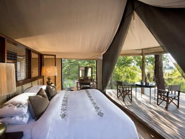 AndBeyond Nxabega Okavango Tented Camp bed