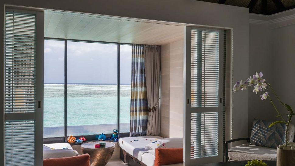 Four Seasons Resort Maldives at Kuda Huraa Sunrise family water villa with pool