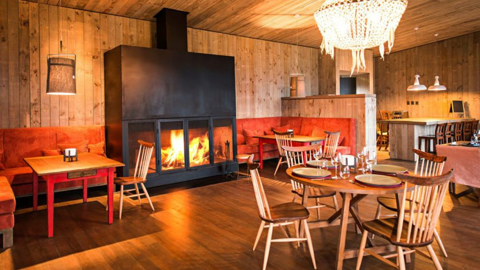 Awasi Patagonia Lodge Dining Area with Fireplace