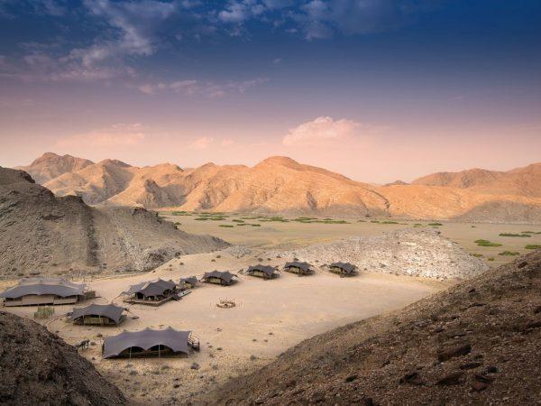 Hoanib Valley Camp Arial tents at dusk
