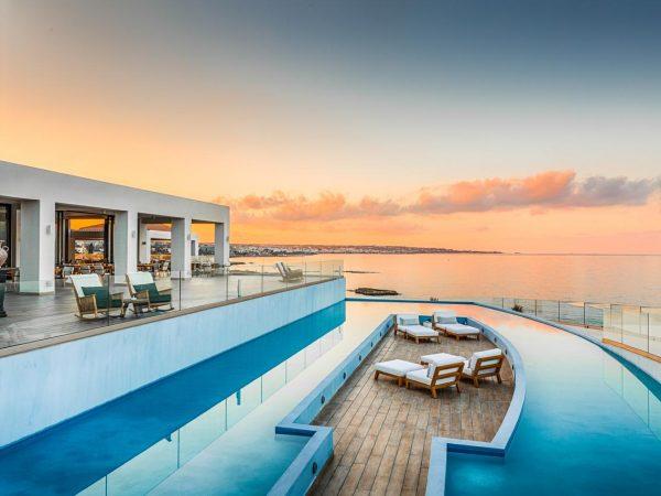 Abaton Island Resort And Spa Pool Sunset